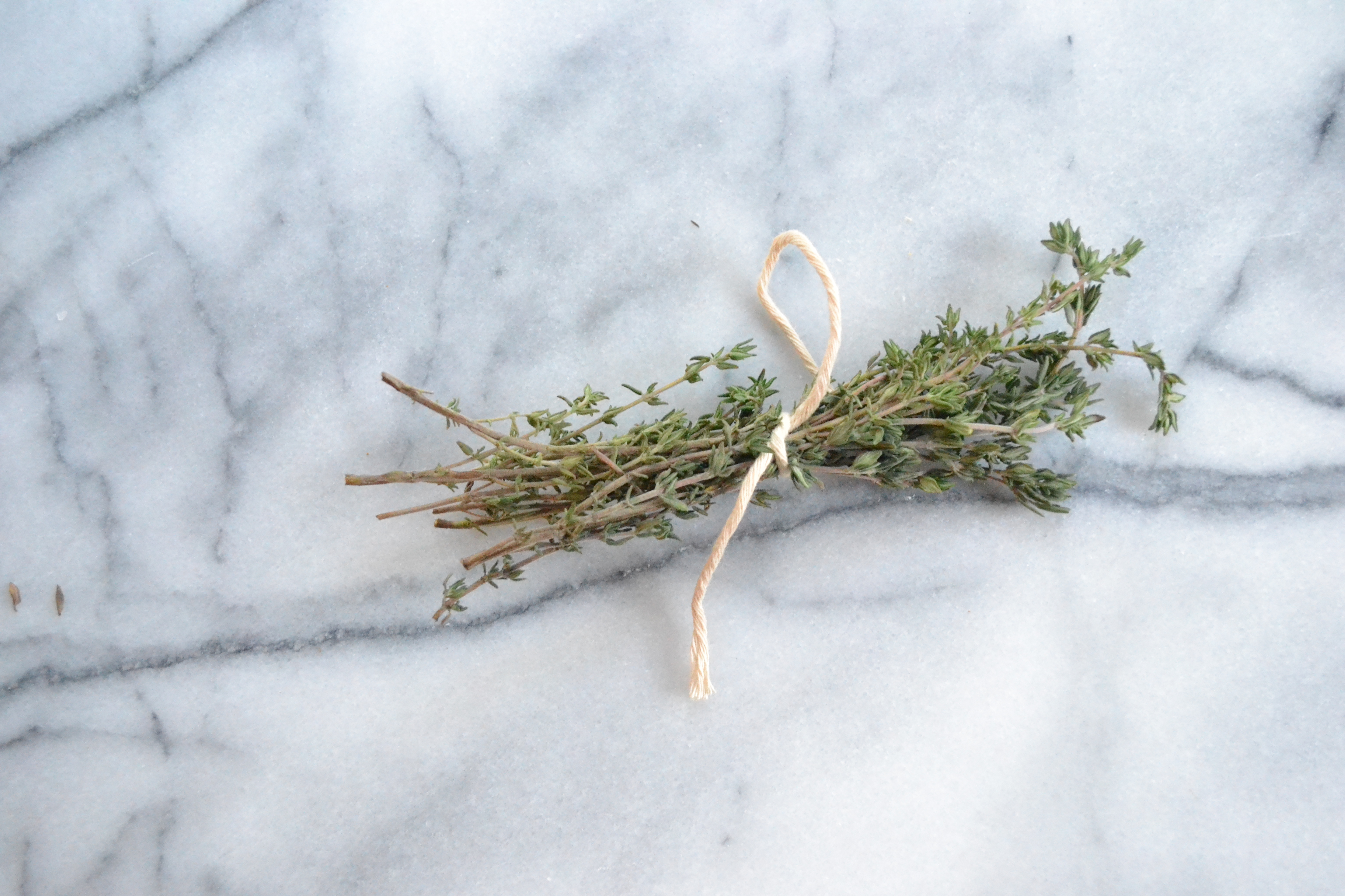 Make sure to tie the thyme together with kitchen twine so it's easier to fish it out at the end.